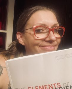 Rachel Rose with the book The Elements of User Experience.